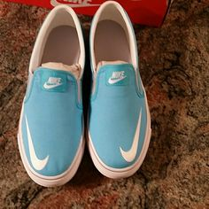 4f3557e413d3 Nike slip on shoes Light blue   white Brand new never worn. Size 7 youth