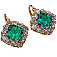 Antique French Emerald Diamond Gold Earrings. A pair of 18K gold French earrings, c. 1890, set with two emeralds: approximately 1.66 ct and 1.67 ct of excellent color and strong saturation ( vstbG 6/4 and vstbG 5/4). The emeralds are surrounded by 24 rose cut diamonds and 24 old mine diamonds (G-H color, VS-SI clarity). Estimated total diamond weight 2.12 ct. c1890