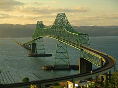 The Astoria-Megler Bridge spans about 4 miles across the mouth of the Columbia River, connecting Oregon and Washington States.i have never been here but would be cool to travel the whole state of oregon Oh The Places You'll Go, Places To Travel, Places To Visit, State Of Oregon, Oregon Coast, Wa State, Oregon Usa, Scary Bridges, Astoria Oregon