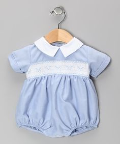 Made from the softest stuff around, this pima cotton bodysuit will envelop any bundle of joy in a world of cuddle-worthy coziness. The hand-smocked bodice, Peter Pan collar and handy snaps add a lot of charm to this sweet wonder. 100% pima cotton