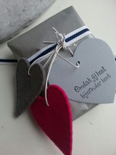 Wrapping with hearts Perfect example to show how easy it could be to make a simple looking wrapping paper or gift box much more attractive with a nice hanger or tag.