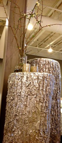 Gold painted tree trunks - rustic, but with a hint of bling!