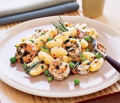 Pasta Dishes Under 450 Calories: Potato Gnocchi With Shrimp and Peas. Let the supermarket help you on this one and buy the gnocchi frozen. Then it's just a matter of marinating the shrimp and throwing this flavorful dish together. #SelfMagazine