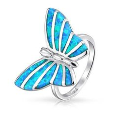 Bling Jewelry 925 Sterling Silver Blue Opal Inlay Butterfly Animal... ($37) ❤ liked on Polyvore featuring jewelry, rings, blue, blue ring, sterling silver band rings, sterling silver butterfly ring, long rings and opal band ring