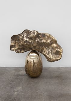 // alma allen Like steel gridded out coral welded on top of a ball of carved wood