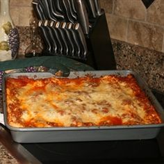"This is a great starter recipe for kids trying to get their ""feet wet"" in the kitchen. My oldest daughter has been making this lasagna since she was 7 years old and does most of the steps on her own, with just a little assistance from us when she needs it. When the lasagna is done, it will be bubbly, hot, and super juicy. Letting it sit at room temperature allows it to cool enough to eat and for the pasta to absorb the extra juices.  - Kids Extra Easy Lasagna"