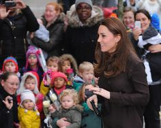 On Friday, Kate Middleton stopped by the Fostering Network, a foster care charity in London, and the Duchess, who is approximately 26 weeks pregnant, sported a barely-there bump underneath her dark brown shirtdress.  STORY: Are Kate Middleton's High Heels Dangerous For Her Pregnancy?  I've always heard that you show sooner with your second pregnancy, but Kate — who didn't pop until she was about 8 months along with Prince George — certainly doesn't look like someone who is six months…