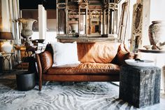 Vintage leather love seat, new in our showroom. The gorgeous patina of age is our favorite textures. Georgia Brown Home Houston.