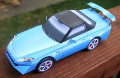 Build Your Own Honda S2000 Paper Model - by Paper Cruiser - == -  Commissioned by Honda Parts Online, Paper Cruiser created this very well done paper model version of the Japanese classic Honda S2000. Occupying four sheets of paper, this not a so hard-to-build model.