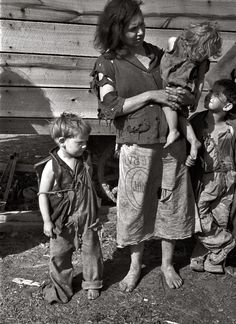 Appalachian Great Depression - The mother in a family of nine holds her baby.