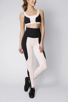 Color-blocked legging with adjustable fold-over waistband. Complimentary shipping on all US orders.