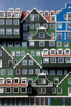 """A unique structure, it represents nearly 70 stacked wooden houses in the regional and traditional """"Zaanse stijl""""."""