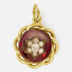 A Victorian garnet and diamond pendant and chain