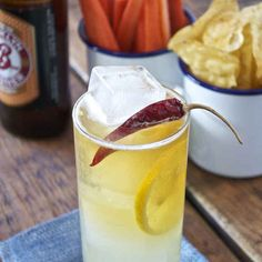 The Three And Out  |  Makes Two Drinks 2 Shots of Vodka 2 Shots of Fresh Lemon Juice 1 Shot of Honey 1 Dried Chile Pepper (split in half) Pilsner Beer