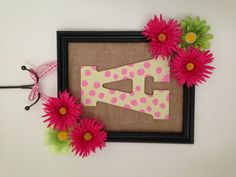"""Framed Door Decor for little girls room...Used an old frame, some leftover burlap, silk flowers that were on sale at Michael's and painted a wooden letter """"A"""" with light green and pink paint and finished it with some ribbon to hang.. Love how it turned out."""