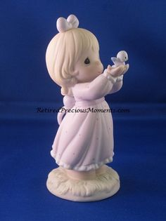 $37.50 Sharing A Gift Of Love - Precious Moment Figurine