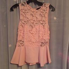 Light pink peplum top. Lace on to with attached under garment underneath lace and is a light pale pink and the peplum part silky material. Never been worn. Tops Tank Tops