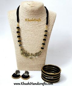 Black Silk Thread Jewelry Set with Jhumkas and Bangles-Handmade Indian Jewelry This jewelry listing set consists of one necklace which is made of Black silk thread wrapped beads with Multiple leaf pendant. The matching Jhumkas with bangles compliment this neck-piece.