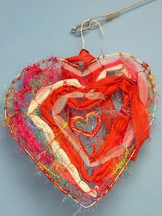 A, 5th grade boy, and his heart using a wire hanger, fabric scraps and ribbon; GREAT
