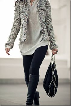 Gray, white, and black jacket with white shirt, jeans, and comfortable boots. Perfect for a chilly day!