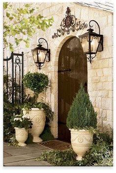 Love the asymmetrical planters and gas lanterns