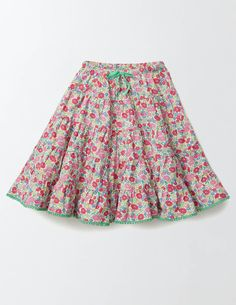 Twirling just got more fun with this five-tier woven skirt. With soft gathers for extra fullness and a pompom trim, it's the perfect thing to wear to birthday bashes and other glittery occasions. The lightweight fabric will keep you nice and cool as you whirl to your heart's content.