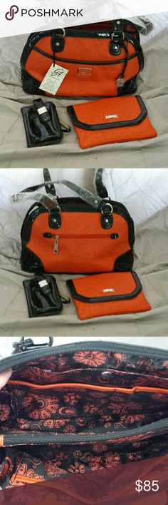 Grace Adele handbag Orange and black ostrich handbag with matching clutch and small black credit card case. This bag has lots of compartments for organization. Grace Adele Bags Shoulder Bags