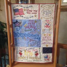 """Independence Day"". Original design of machine embroidery and quilting by Patty Calhoun, 7/2016. Wall hanging."