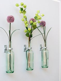 Wall vases made from wine bottles.