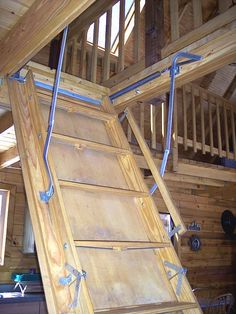 pull down loft ladder.  You can put this out of the way during the day and it's easy to climb up and down, unlike rung ladders.