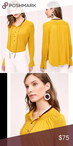 Goldie Blouse by Akemi + Kin Ultra soft rayon-spandex blouse features intricate detailing around the neckline with colorful ties, pullover styling Anthropologie Tops Blouses