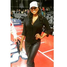 Holding down the court!  Teresa is wearing leather jeggings with a black button-down shirt and a Detroit Pistons women's cap.