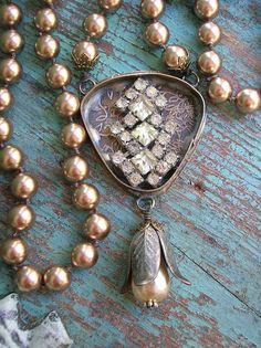Necklace with a soldered pendant with etched brass and vintage rhinestones