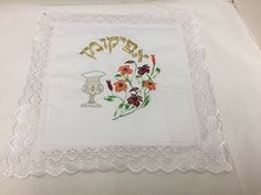 You are viewing afikomen matzah holder for a Passover Seder. Embroidered with a kiddush cup and flowers. There are stains. Passover Meal, Passover Recipes, Kiddush Cup, Beauty Supply, Floral Embroidery, Candlesticks, Hanukkah, Linens, Stains