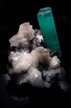 Aquamarine on Calcite.