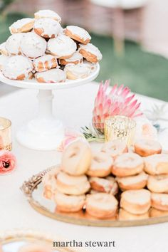Donut walls have gained popularity at weddings over the last couple years. Rethink that trend by displaying these desserts in a pyramid shape, instead, à la this M Cakes Sweets creation. The result? A treat that resembles a wedding cake, but still deviates from tradition. #weddingideas #wedding #marthstewartwedding #weddingplanning #weddingchecklist Bridal Shower Desserts, Dessert Bar Wedding, Wedding Donuts, Wedding Desserts, Dessert Table, Wedding Cakes, Donut Bar, Wedding Cake Alternatives, Creative Desserts