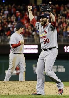 St. Louis Cardinals relief pitcher Jason Motte, front, and third baseman David Freese react after Game 5 of the National League division baseball series against the Washington Nationals on Saturday, Oct 13, 2012, in Washington. St. Louis won 9-7