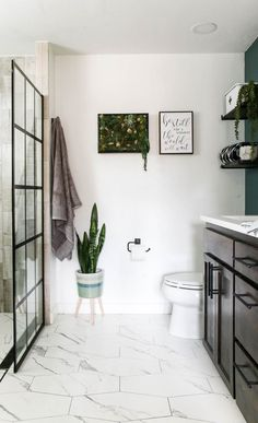 This bathroom has a brand new layout with his and her dual head shower on one side and the toilet and dual sink vanity on the other. I love the dark green accent wall and succulent wall decor in frame. Green Accent Walls, Green Accents, Bathroom Interior, Modern Bathroom, Bathroom Ideas, Bath Ideas, Bathroom Designs, Succulent Wall, Succulent Planters