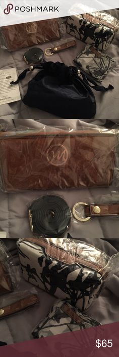 Emilie M. Essentials box Brand new ... includes  crossbody wallet...makeup pouch....umbrella.... scarf.... key keeper all still in original plastic never opened ....pocketbook is NOT included!!! Used the picture to show product outside of the plastic don't want to open anything in case you want to gift this ! 😉 Accessories