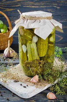 Tips for preserving your fruits, herbs, and vegetables with instructions for how to pickle, freeze, and store many fruits and vegetables from The Old Farmer's Almanac. Quick Pickle Recipe, High Acid Foods, Mixed Pickle, Old Farmers Almanac, Kos, Vinegar And Water, Pickling Cucumbers, Growing Veggies, Thing 1