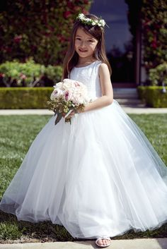 Is there anything cuter? Shop this ball gown flower girl dress at David's Bridal