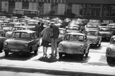 Harald Hauswald's photograph of East Berlin couples looking at new Trabant cars, 1980s