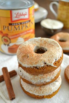 Pumpkin, cheesecake, and plenty of fall spices come together in these super-soft baked donuts—you won't be able to have just one! Recipe by @WholeHeavenly for DessertNowDinnerLater.com