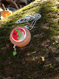 Venus flytrap and black fly handpainted necklace designed by quarkcorks by quarkcorks on Etsy