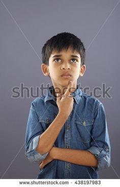 Indian School boy thinking