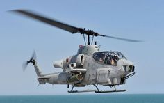 The AH-1W Super Cobra taking off is assigned to Marine Light-Helicopter Squadron (HMLA) 167.
