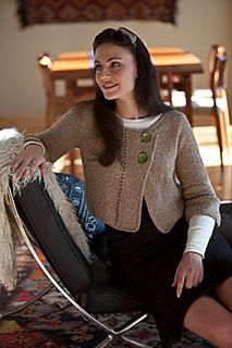 A dolman cardigan knitted from side to side, from one cuff to the other. Eyelet…
