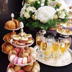 loving these tiered trays for Macaroon's and Champagne. Centerpiece just white hydrangea from Sam's club, clear glass vase with Channel no. 5 lable