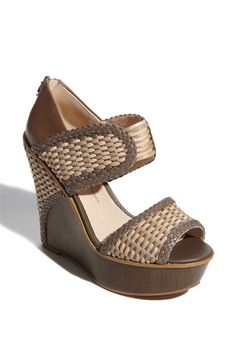 Love the wide woven straps on this one, the wood platform, and the wrap-around detail