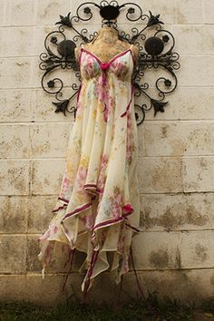 """Second-hand stores are overrun with ugly Easter dresses of yore. Luckily, they sometimes feature some awesome, soft floral prints that make perfect upcycled summer dresses. This """"goddess dress"""" from Lucysroom was chopped up at the bottom with ribbon sewn over-top the edges for a more romantic look."""